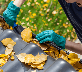 Your Seasonal Maintenance Checklist Cleaning Gutter Image